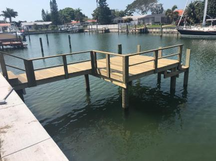 New Wood decking dock with rail and lower landing.