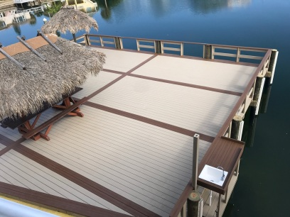 New Commercial Dock with Wear decking, multi-colored decking and picture framed, with rail fish table.