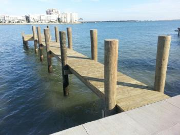 New Wood Dock with bollard poles.