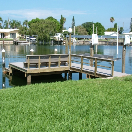 New dock with Azek Decking, Rail, Bench, and Deco Boat Lift in St. Petersburg, FL