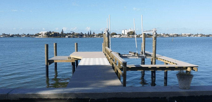 Azek and grated decking dock with catwalk and large lower dock.