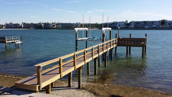 Azek Dock with rail, bench, lower dock, and 10,000LB Deco Boat Lift in St. Pete Beach, FL