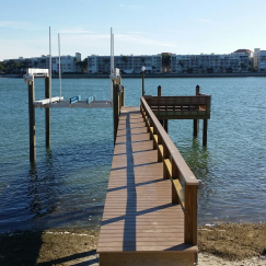 Evergrain Composite dock with rail, bench, lamp post and lower dock. 10,000LB Deco Boat Lift.