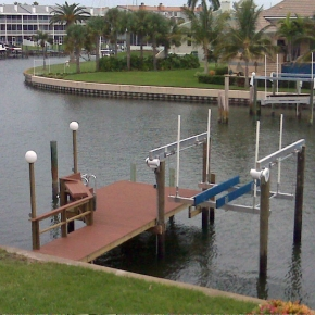 New Evergrain Composite dock with Rail, Fish Table, Lamp Posts, Ladder, and 10,000LB Deco Boat Lift in Tierra Verde, FL