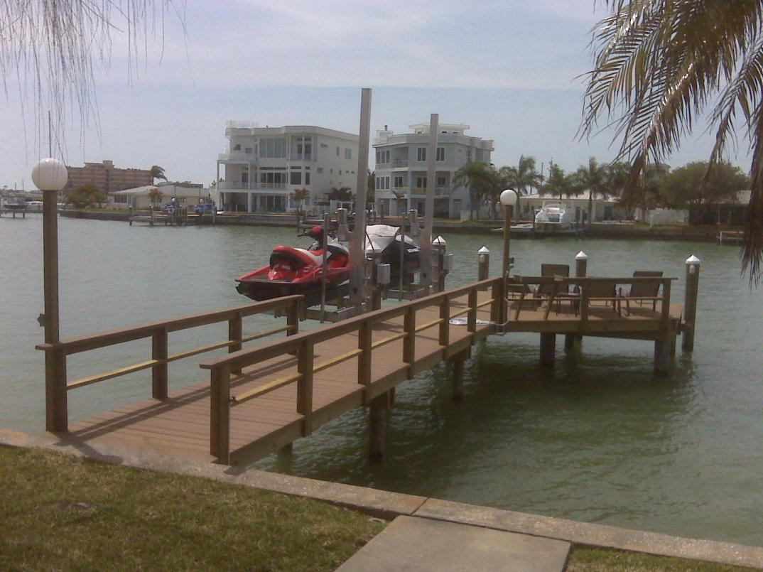 New Evergrain Dock with 2 Swinger jet ski lifts, rail, and lamp posts.